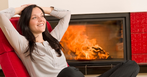 Winter home fireplace woman relax red armchair
